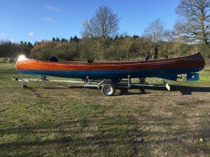 wooden canoe on trailer